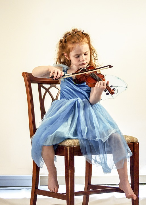 Child learning to play the violin
