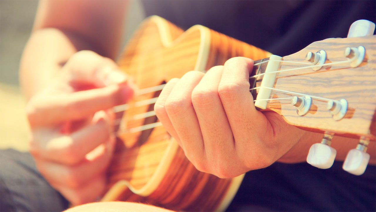 Small and portable ukelele is a great instrument to start